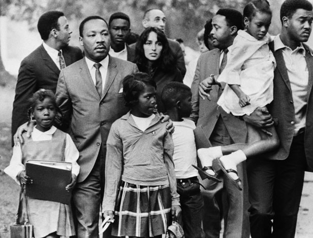 20 Sep 1966, Grenada, Mississippi, USA --- Dr. Martin Luther King is shown leading a group of black children to their newly integrated school in Grenada, Mississippi, escorted by folk singer Joan Baez and two aides, Andy Young (L) and Hosea Williams (next to Baez). --- Image by © Bettmann/CORBIS